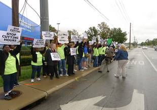 Walmart Associates holding signs on sidewalk