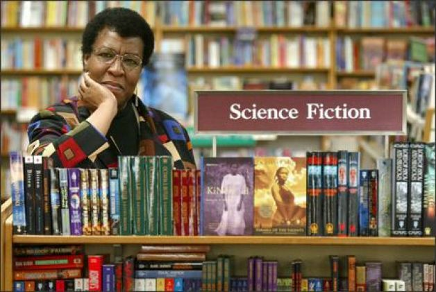 Octavia Butler being a beautiful badass surrounded by her books.