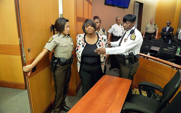 APS teacher being arrested in the wake of the cheating scandal